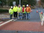 apcon workers installing adbruf crosswalk